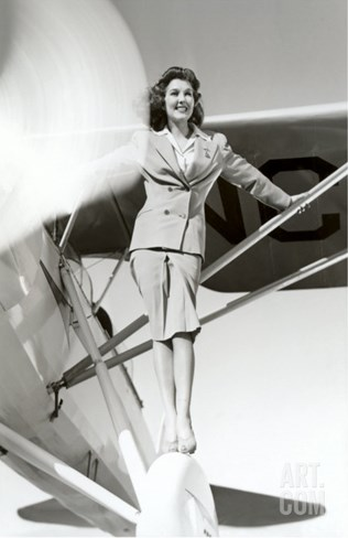 Stewardess Balancing on Plane Wheel Stretched Canvas Print