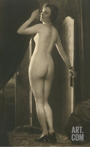 Coy Nude at Wardrobe Door Stretched Canvas Print