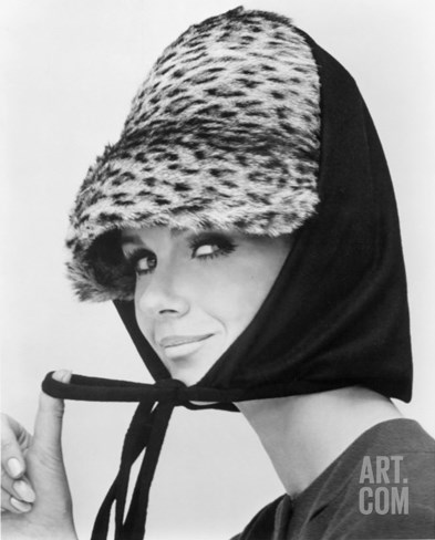 Nicole de la Marge in an Otto Lucas Jersey Scarf over an Ocelot Hat, 1964 Stretched Canvas Print