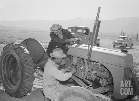 Tractor Repair: Driver Benji Iguchi, Mechanic Henry Hanawa, Manzanar Relocation Center, California Stretched Canvas Print