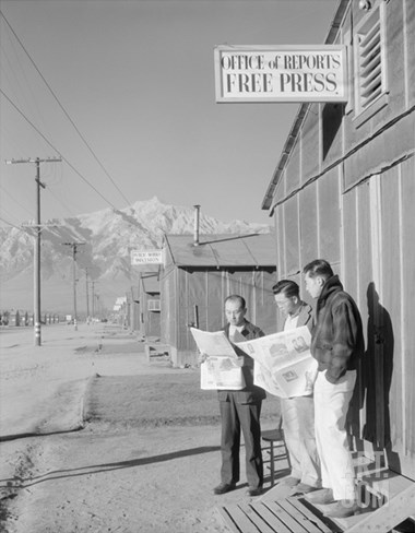 Roy Takeno (Editor) and Group Reading Manzanar Paper [I.E. Los Angeles Times] in Front of Office Stretched Canvas Print