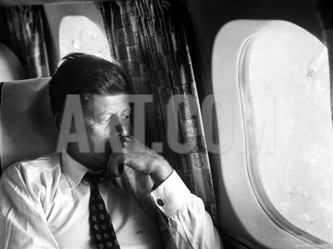 Kennedy on his private plane during his presidential zdroj art.com